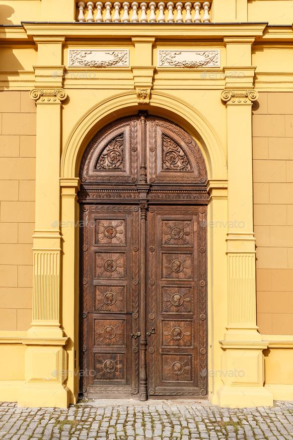 Aged oak street door - Stock Photo - Images