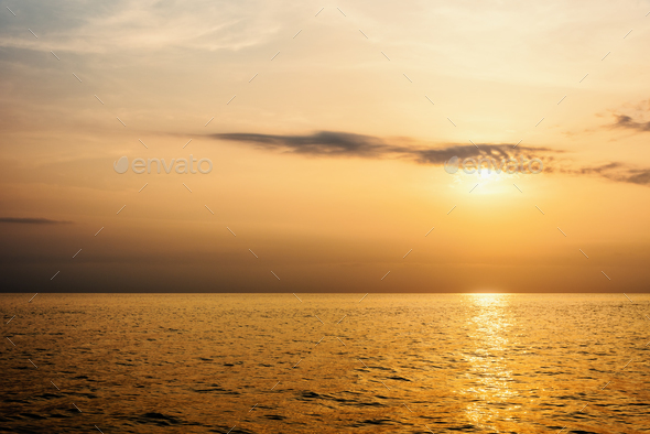 Warm orange light of the sun at sunset - Stock Photo - Images