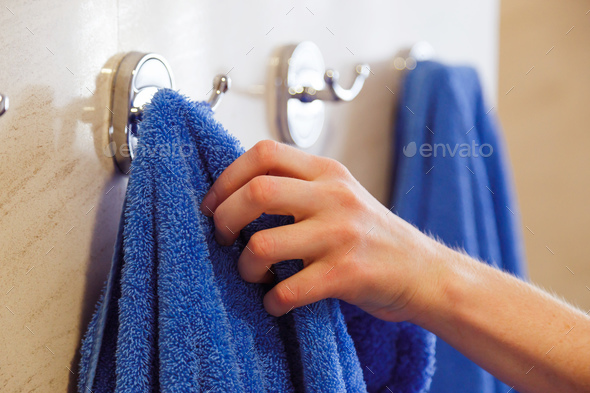 towel for hands hanging on a rack in the bathroom - Stock Photo - Images