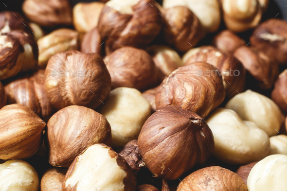 Pile of hazelnuts close-up as background - Stock Photo - Images