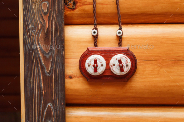 Old fashioned electricity switchs, electric wire on a wooden wall. - Stock Photo - Images