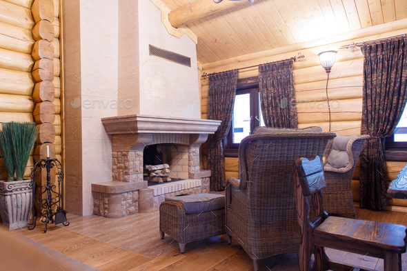 chimney room interior in private house built of logs. - Stock Photo - Images