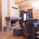 chimney room interior in private house built of logs. - PhotoDune Item for Sale
