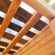 Wooden rafters against the blue sky in house under construction. - PhotoDune Item for Sale