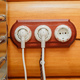 Old fashioned electricity switches, socket, electric wire in on a wooden wall. - PhotoDune Item for Sale