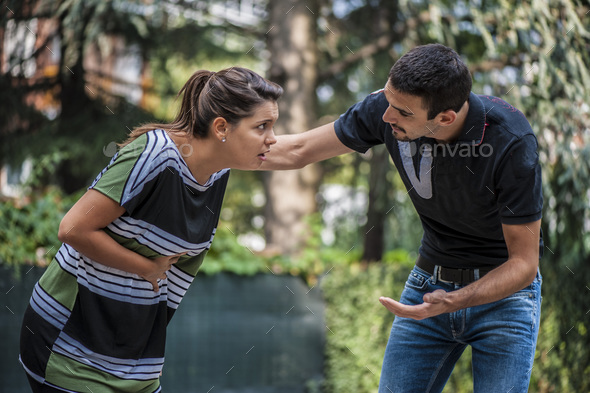 guy helping a girl chocking during feeding - Stock Photo - Images