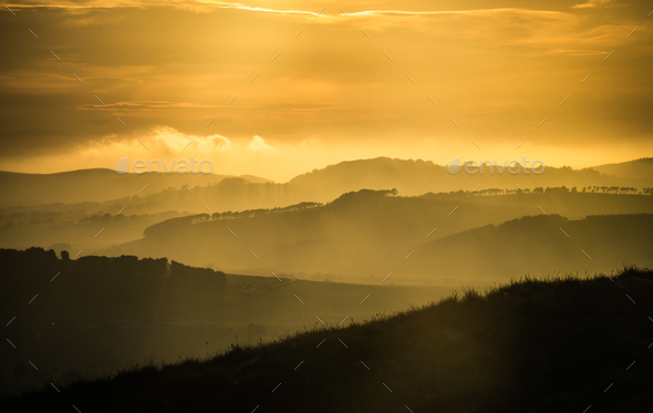 Rolling Hills At Sunset - Stock Photo - Images