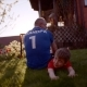 Backshot of Grandfather and Grandson on the Lawn with Soccer Ball on Sunset - VideoHive Item for Sale