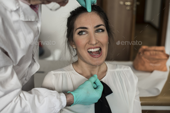a dentist visiting a young girl patient for her pain  - Stock Photo - Images