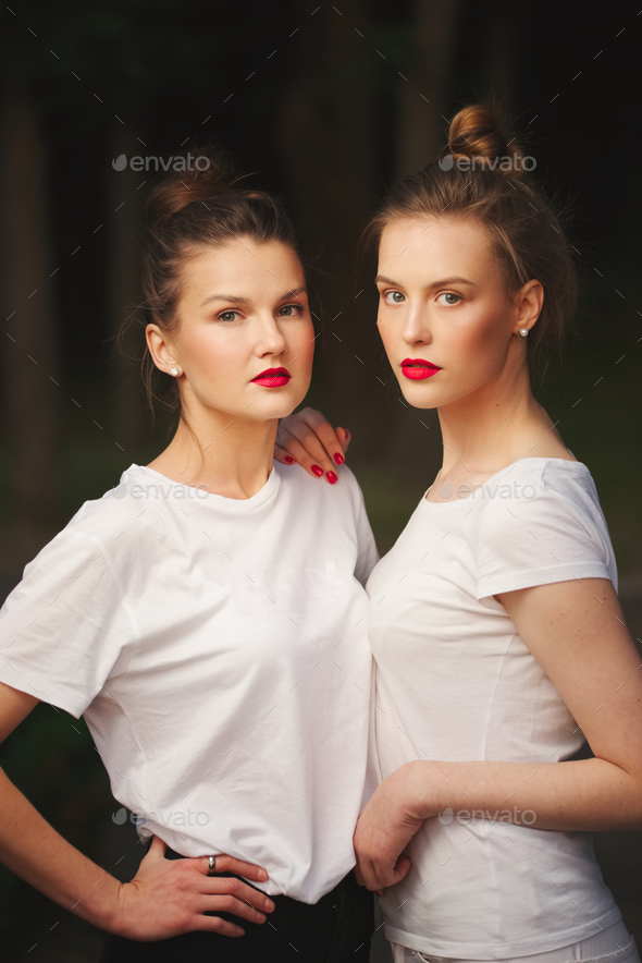 two beautiful girls with red lips - Stock Photo - Images