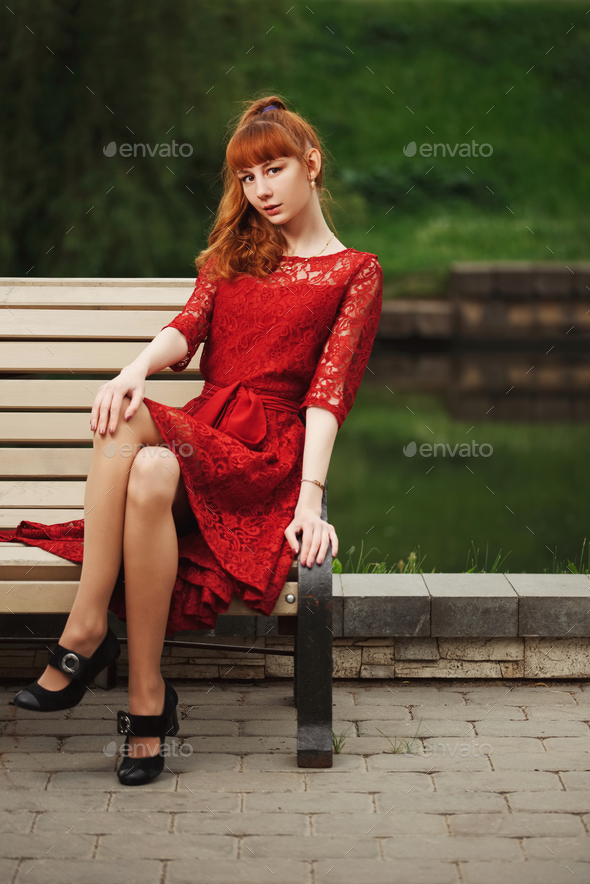 beautiful red haired girl in park - Stock Photo - Images