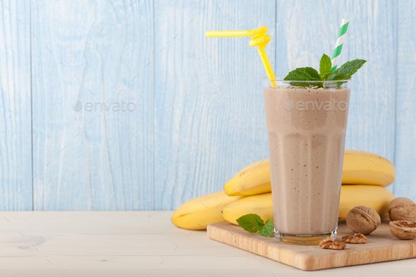 Banana smoothie, bananas and nuts - Stock Photo - Images