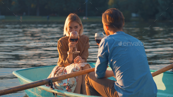 Young couple with a glass of wine - Stock Photo - Images
