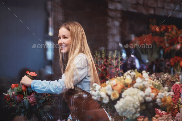 Smiling florist at work - Stock Photo - Images
