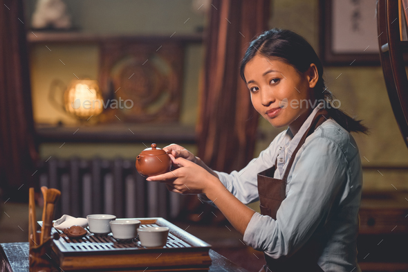 Young tea master in room - Stock Photo - Images