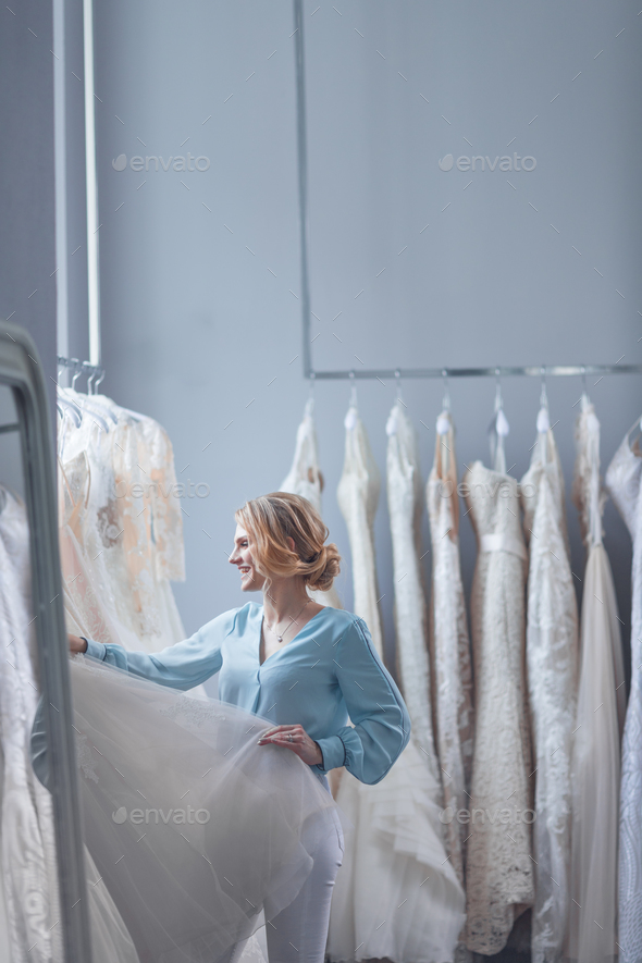 Young customer in a wedding shop - Stock Photo - Images