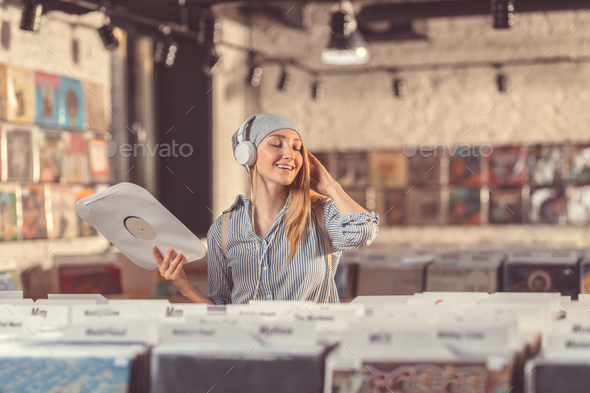 Attractive girl in the record store - Stock Photo - Images