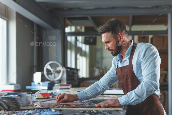 Mature man with mosaic - Stock Photo - Images