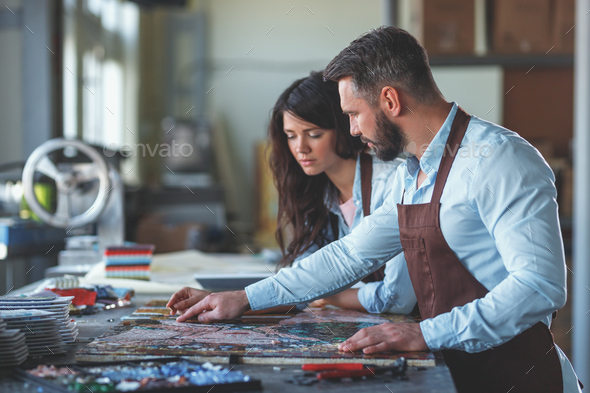 Young professionals with mosaic - Stock Photo - Images