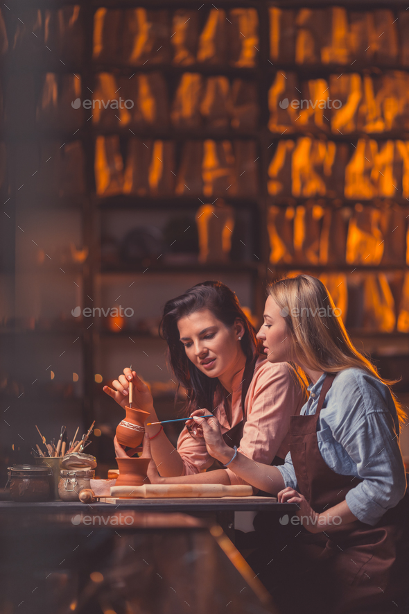 Attractive women drawing indoors - Stock Photo - Images
