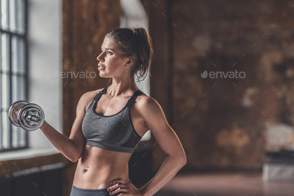 Young girl with a dumbbell - Stock Photo - Images
