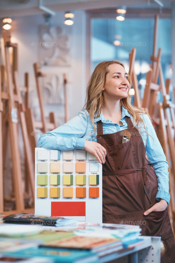 Young girl in an apron - Stock Photo - Images