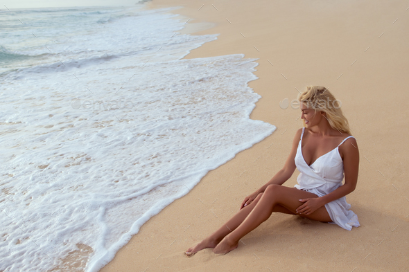 Beautiful girl on the beach - Stock Photo - Images