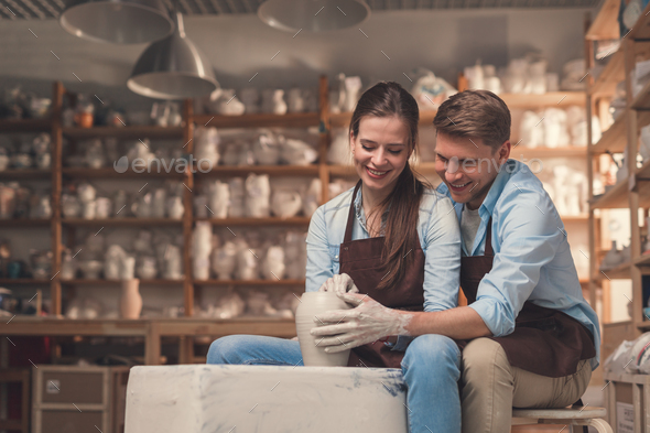 Happy couple at a potter's wheel - Stock Photo - Images