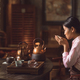 Young asian girl drinking tea - PhotoDune Item for Sale