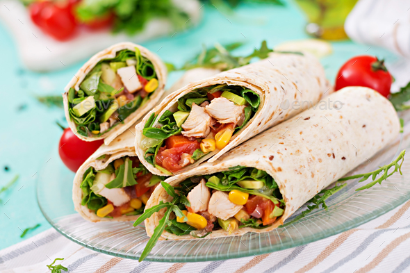 Burritos wraps with chicken and vegetables on light  background. Chicken burrito, mexican food. - Stock Photo - Images