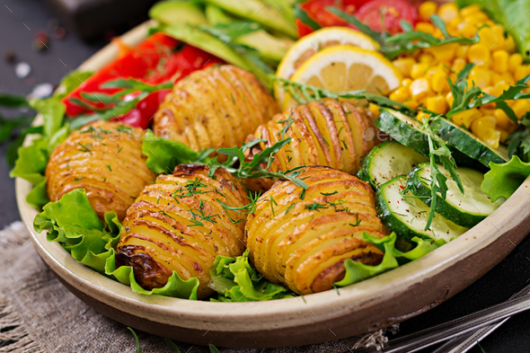 Vegetarian buddha bowl. Raw vegetables and baked potatoes in  bowl. - Stock Photo - Images