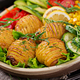 Vegetarian buddha bowl. Raw vegetables and baked potatoes in  bowl. - PhotoDune Item for Sale