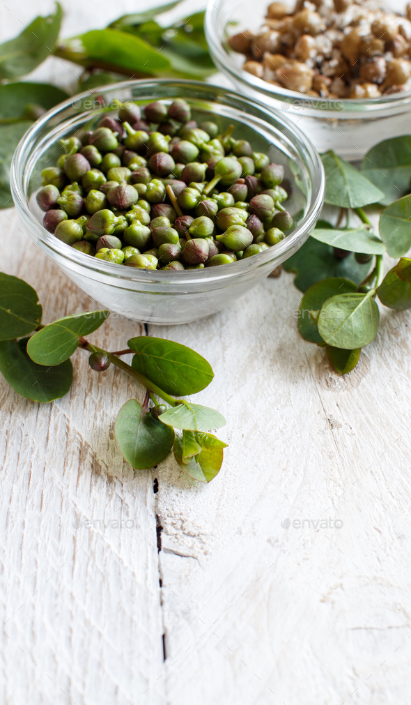 Fresh and salted capers - Stock Photo - Images