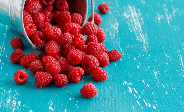 Fresh raspberries in a bucket - Stock Photo - Images