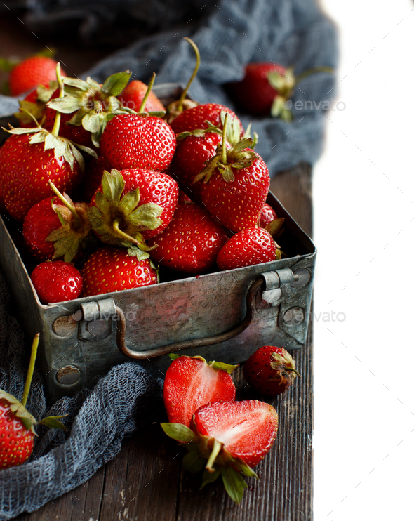 Strawberries in a box on a  table - Stock Photo - Images