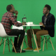 Two African Men Sit at a Cafe Table and Talk. Green Studio - VideoHive Item for Sale