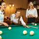 Young women playing billiards at office after work. - PhotoDune Item for Sale