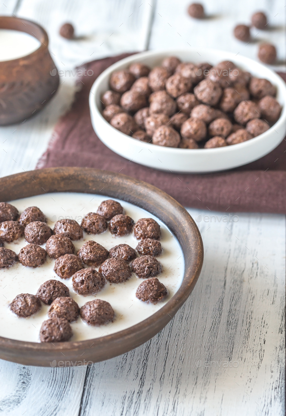 Bowl of chocolate corn balls with milk - Stock Photo - Images
