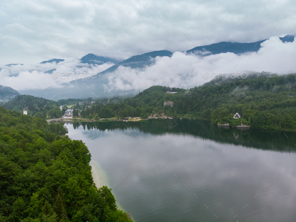 Cloudscape over Bohinj Lake in Slovenia, aerial drone view - Stock Photo - Images