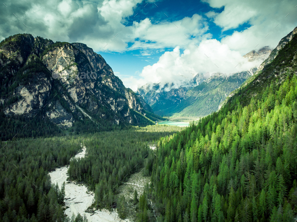 Amazing view over Dolomites peaks, forest and river,Italy, aeria - Stock Photo - Images