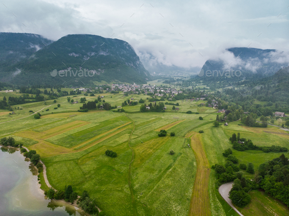 Rural landscape and Julian Alps, aerial view - Stock Photo - Images