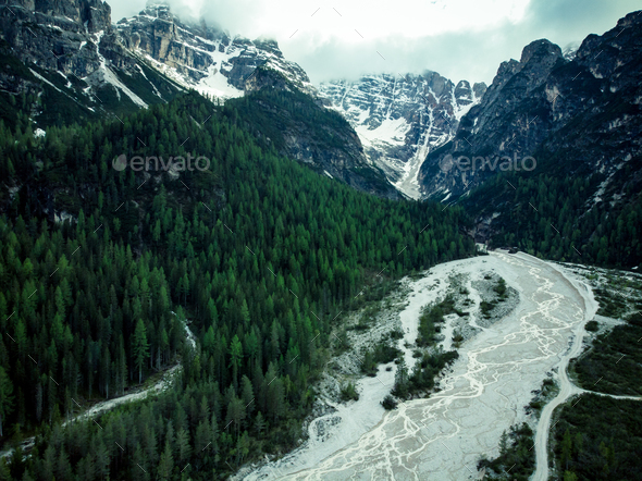 Dry river pattern in alpine forest, drone aerial view - Stock Photo - Images
