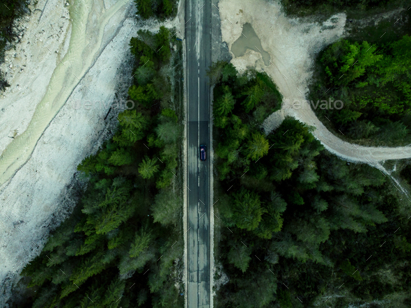Car driving on alpine road in forest, top down aerial drone view - Stock Photo - Images