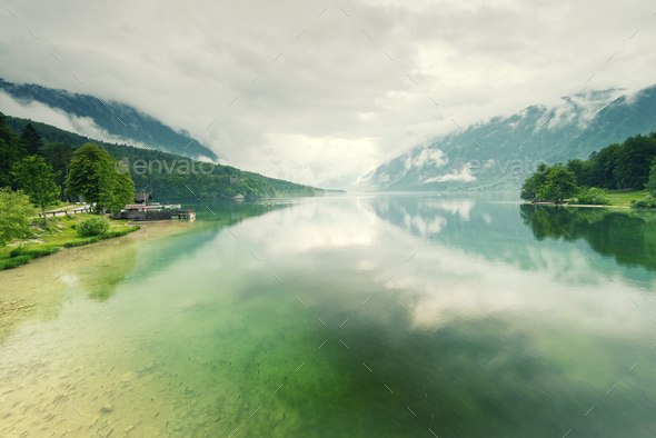 Beautiful calm and cristal clear lake water - Stock Photo - Images