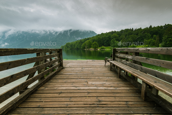 Wooden pier leading into Bohinj Lake, Slovenia - Stock Photo - Images
