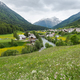 Village in valley in Switzerland at summer time - PhotoDune Item for Sale