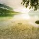 Sun glare at Bohinj Lake in Slovenia - PhotoDune Item for Sale