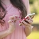 Girl Uses Mobile Phone Outdoor. Holds in Hands His Smartphone. Attractive Girl Uses Smartphone - VideoHive Item for Sale