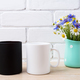 White and black mug mockup with cornflower and daisy - PhotoDune Item for Sale
