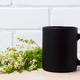 Black coffee mug mockup with white spiraea flowers - PhotoDune Item for Sale